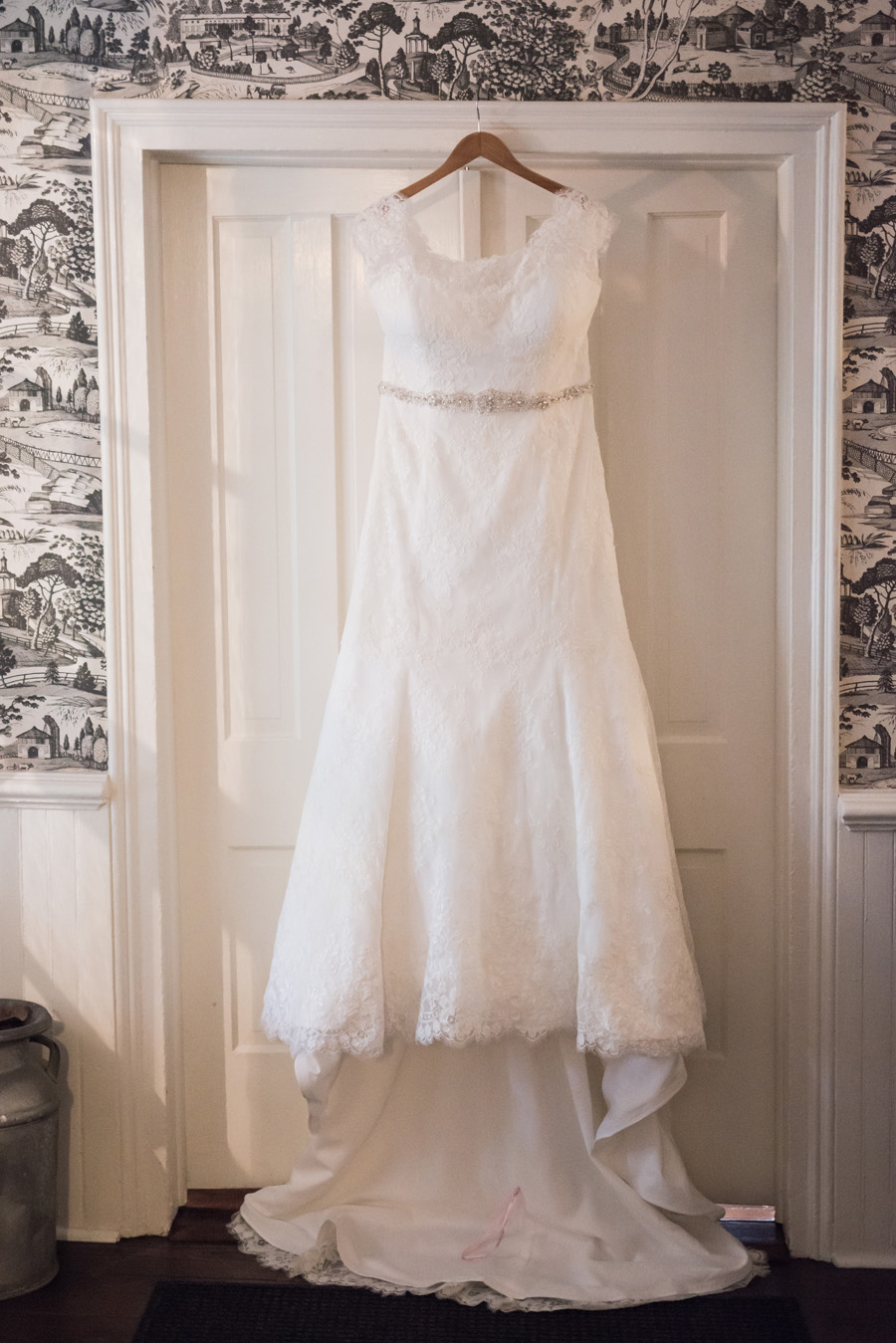 Detail photo of dress hanging up.