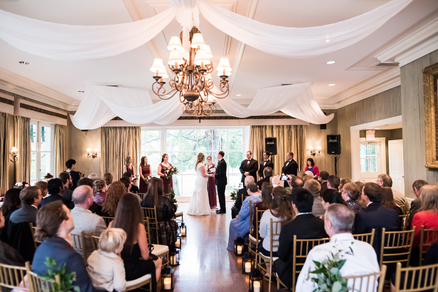 Overall view of wedding ceremony at Dunham Woods Riding Club.