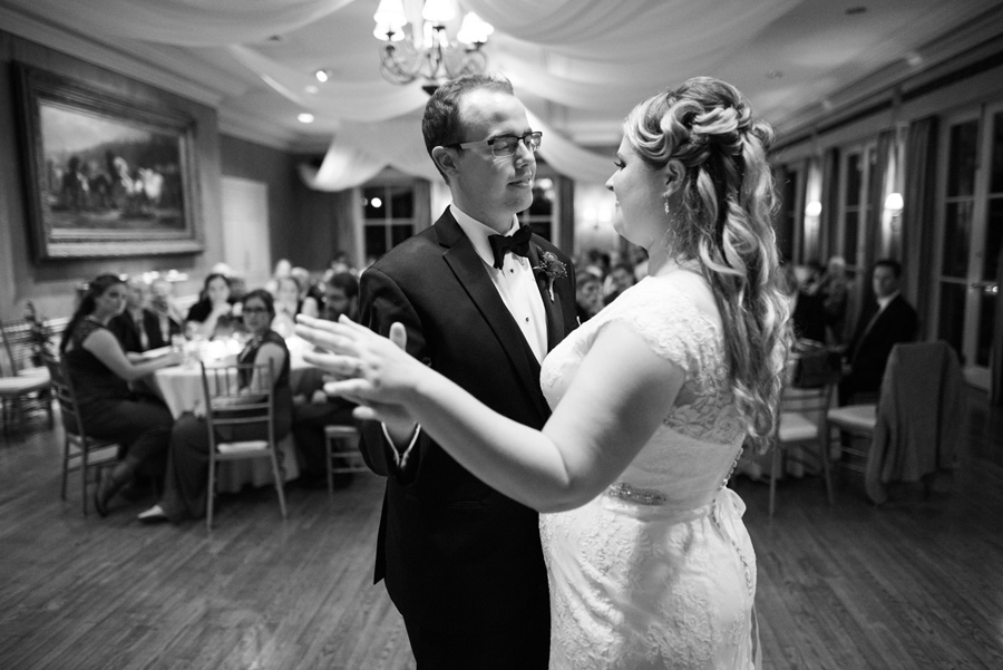 Bride and groom share a first dance at wedding reception.