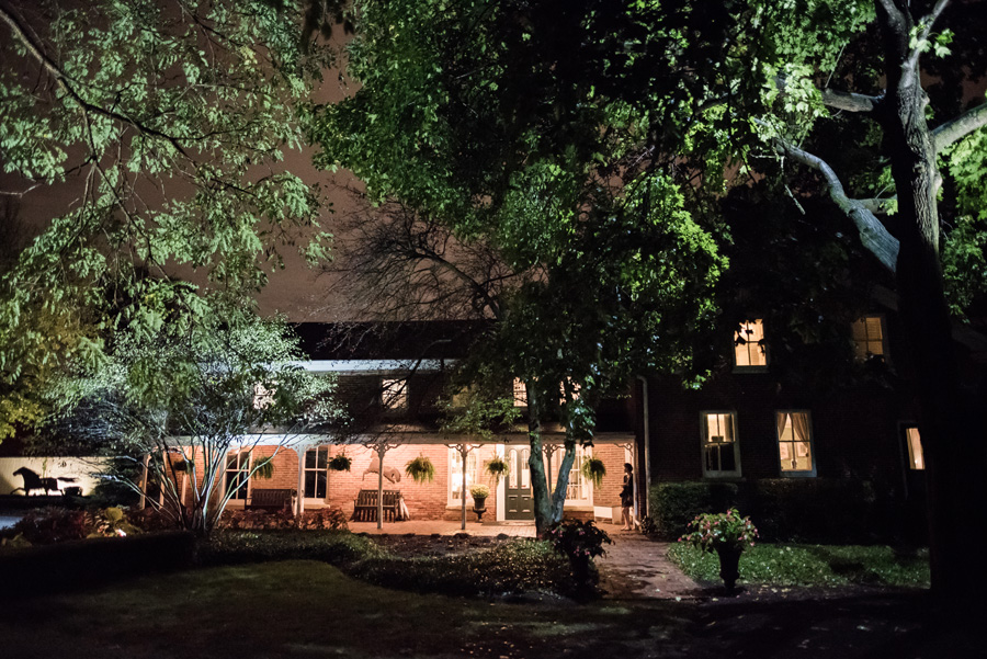 Night time photo of the exterior of Dunham Woods Riding Club.