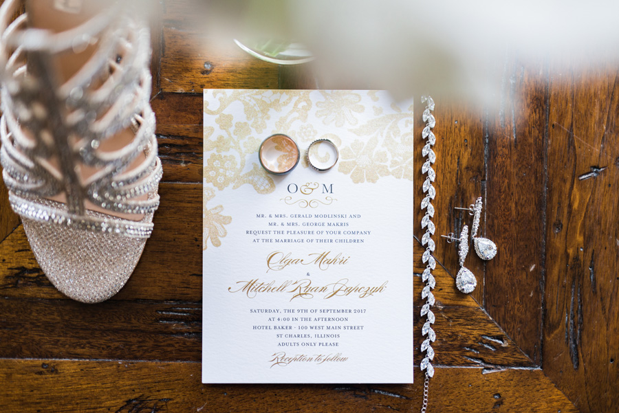 Wedding details, invitations, rings and flowers.
