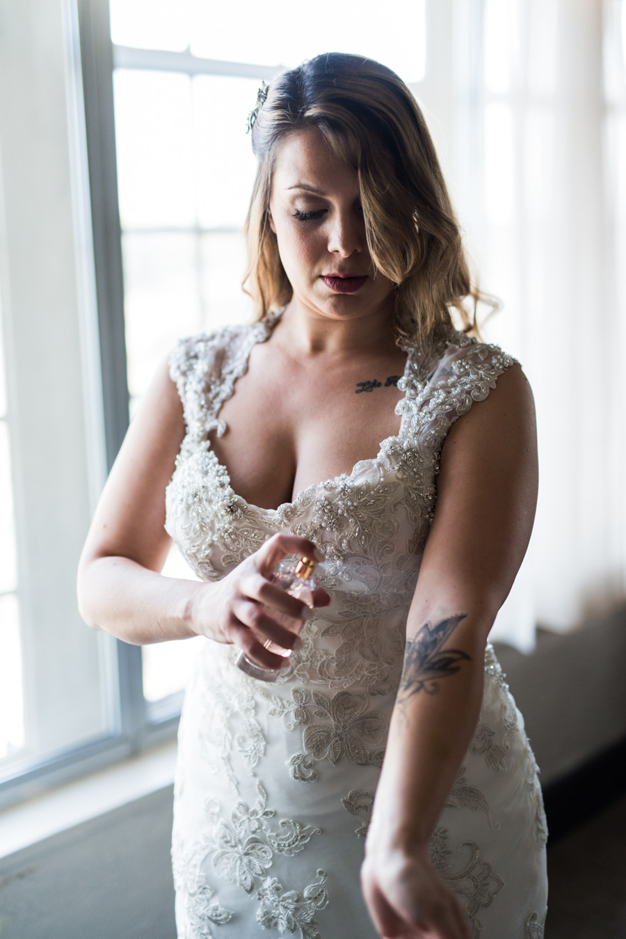Bride puts on perfume.