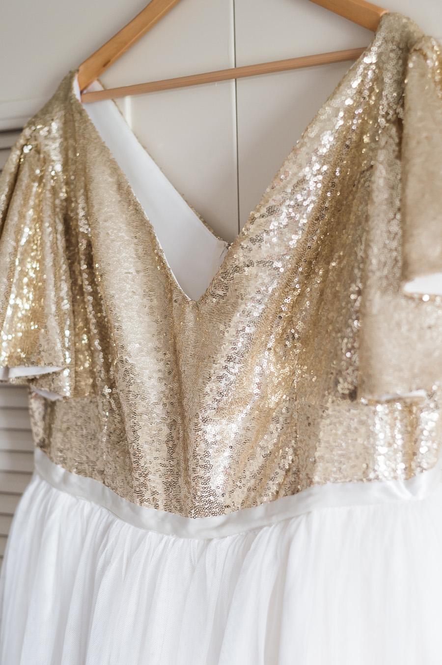 Bride's sparkly wedding dress.