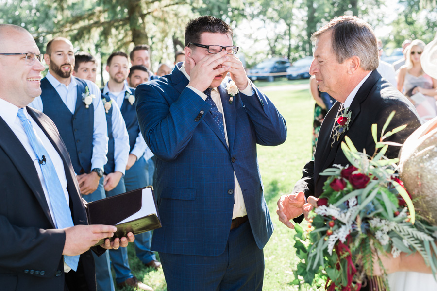 Groom's reaction to seeing his bride walking down the aisle.