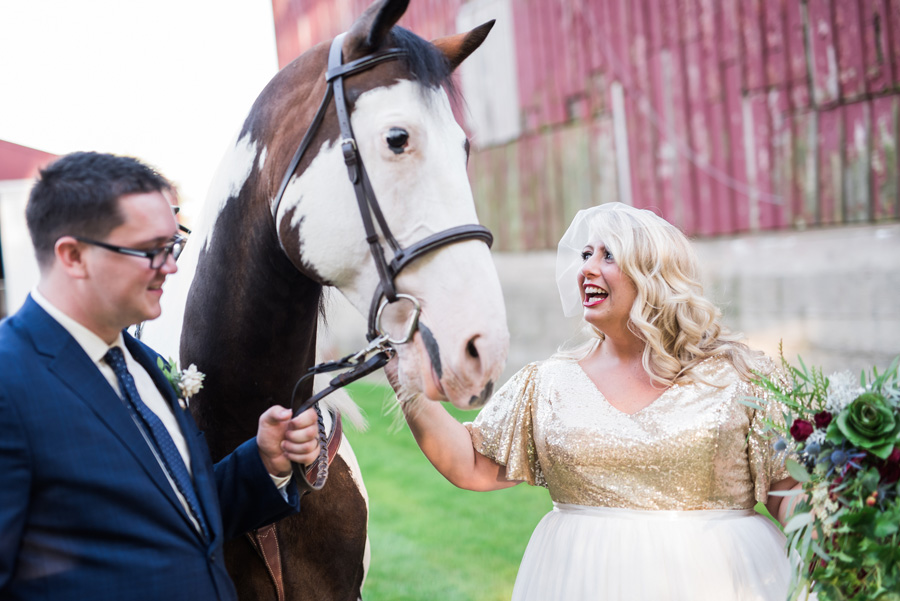Bride and groom photo with horse.