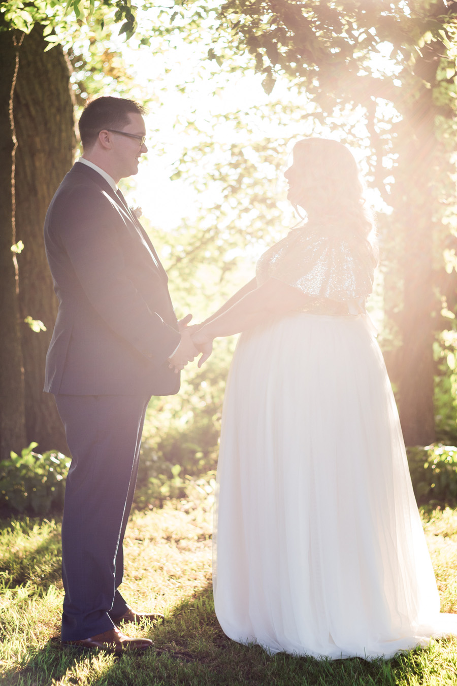 Bride and groom with sunset.