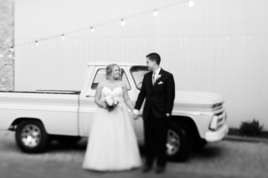 Bride and groom with vintage truck at Warehouse 109.