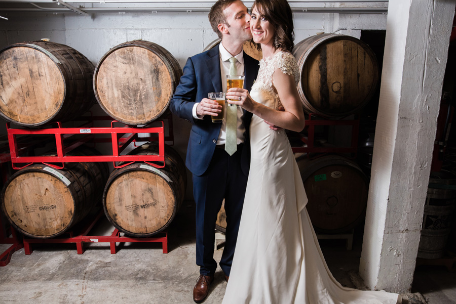 Bride and groom portraits in barrel room at Revolution Brewing.