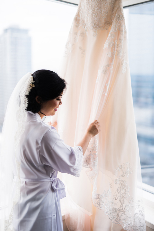 Bride looks at her dress.