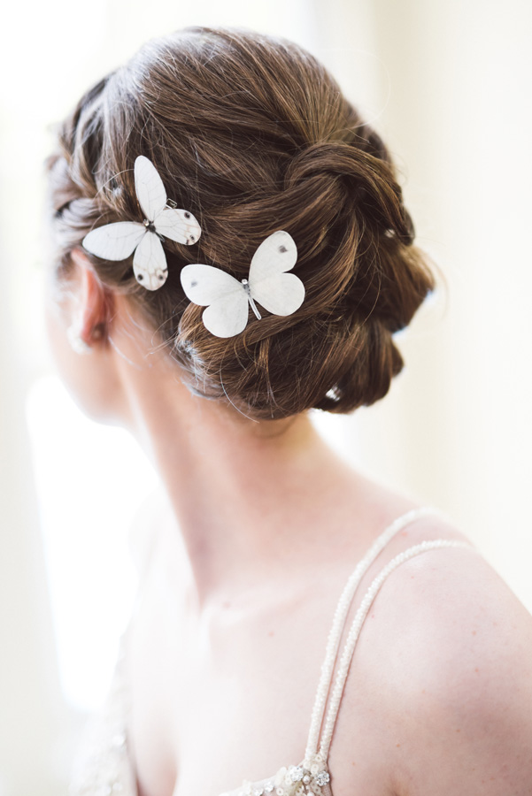 Butterfly hair pins on bride.
