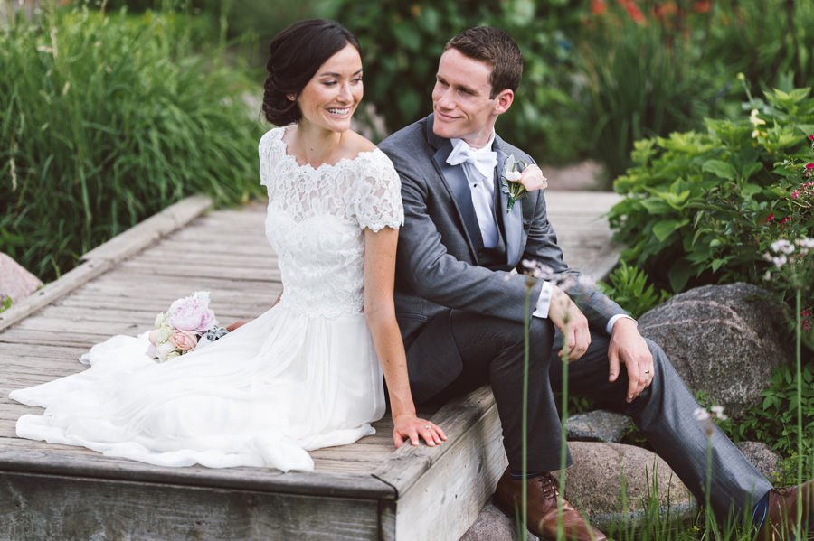 Portrait of bride and groom on dock at Cantigny Park.