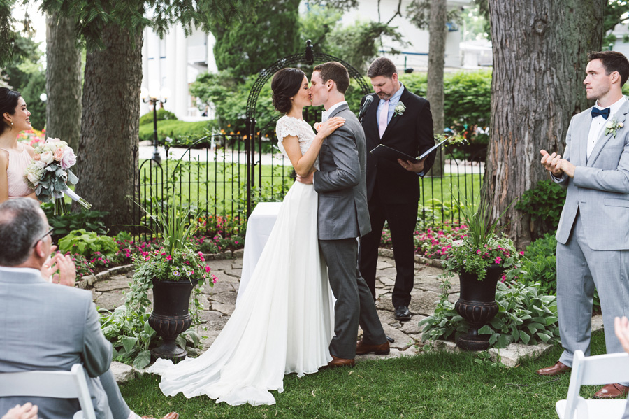 Bride and groom kiss at their wedding ceremony.