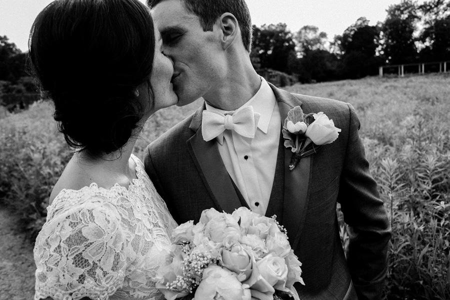 Bride and groom kiss at Cantigny Park.