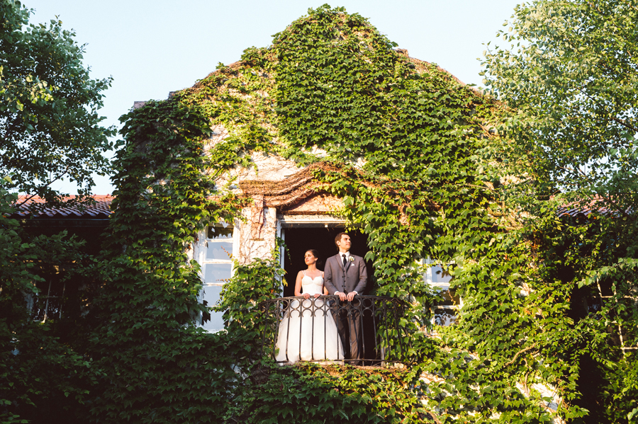 Bride and groom in balcony at Ravisloe Country Club.