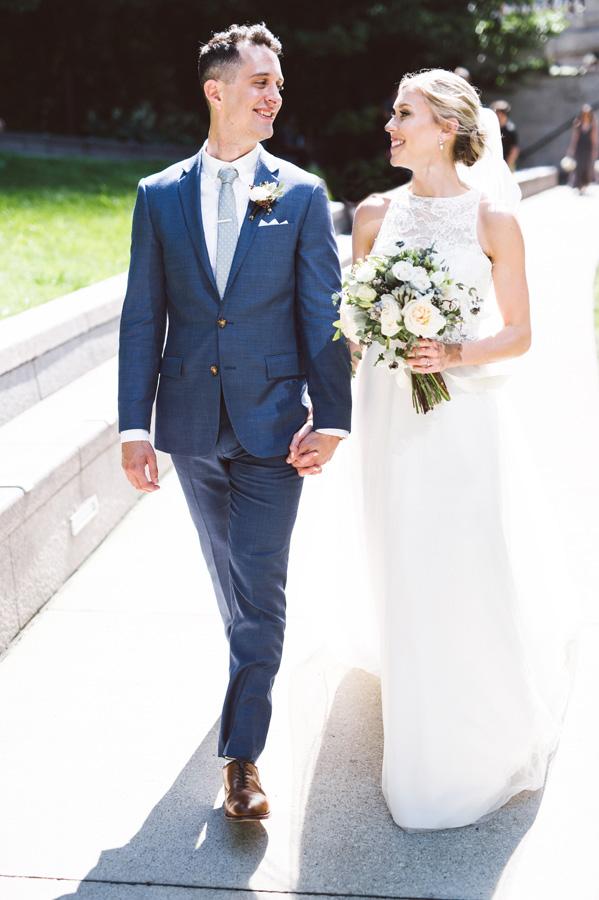 Bride and groom walking down path at Riverwalk.