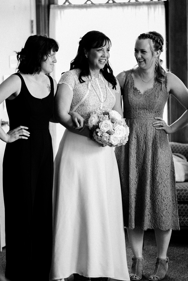 Bride with her daughters about to walk down the aisle.
