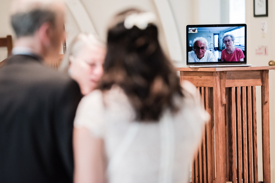 Mom and Dad facetime during wedding ceremony.