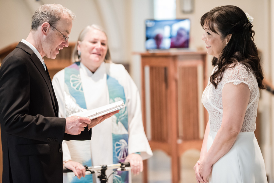 Bride and groom exchange vows at wedding ceremony.