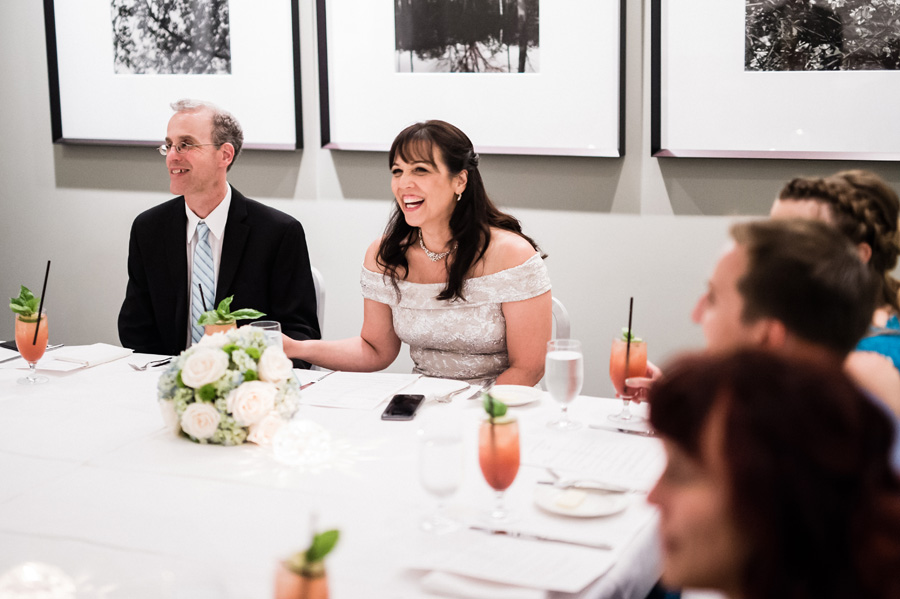 Bride and groom react to dad's toast.
