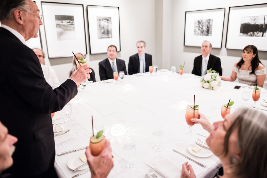 Dad gives toast at wedding reception.