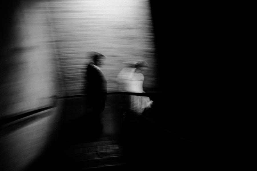 Bride and groom walking down stairs.