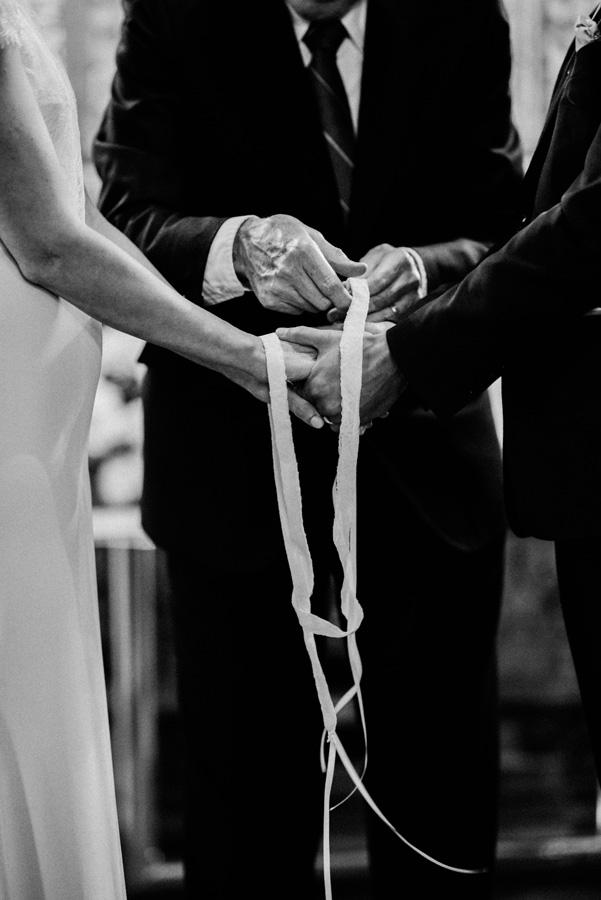 Bride and groom Irish hand tying tradition.