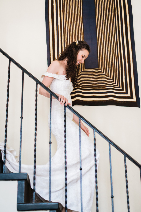 Bride walks down the stairs at the Freehand hotel.