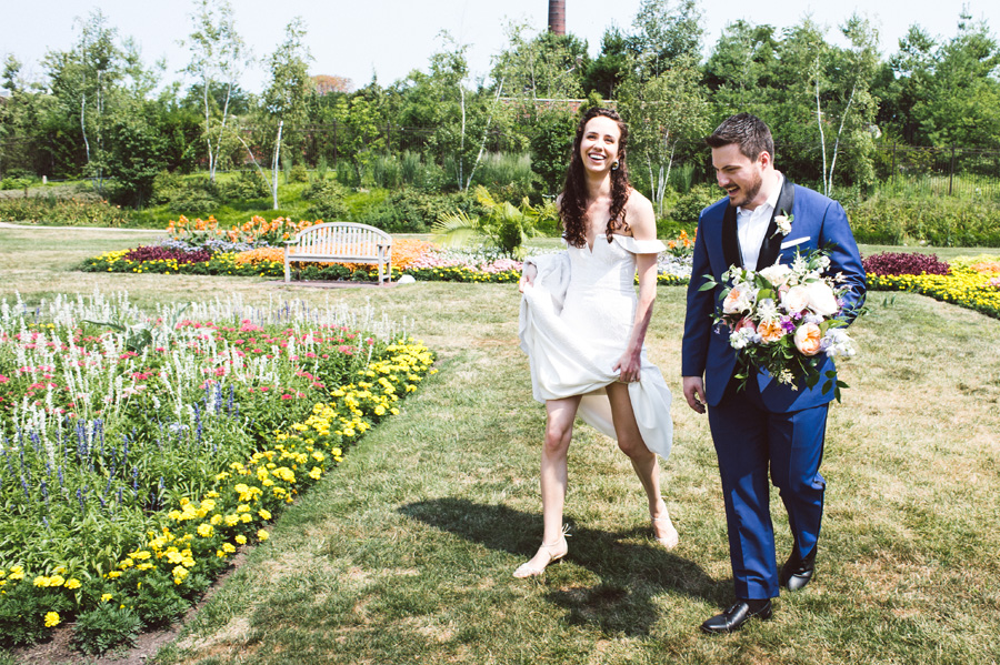 Bride and groom walk through Lincoln Park.
