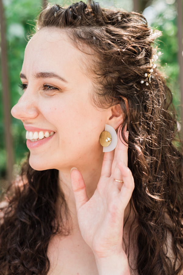 Portrait of bride and earring detail.