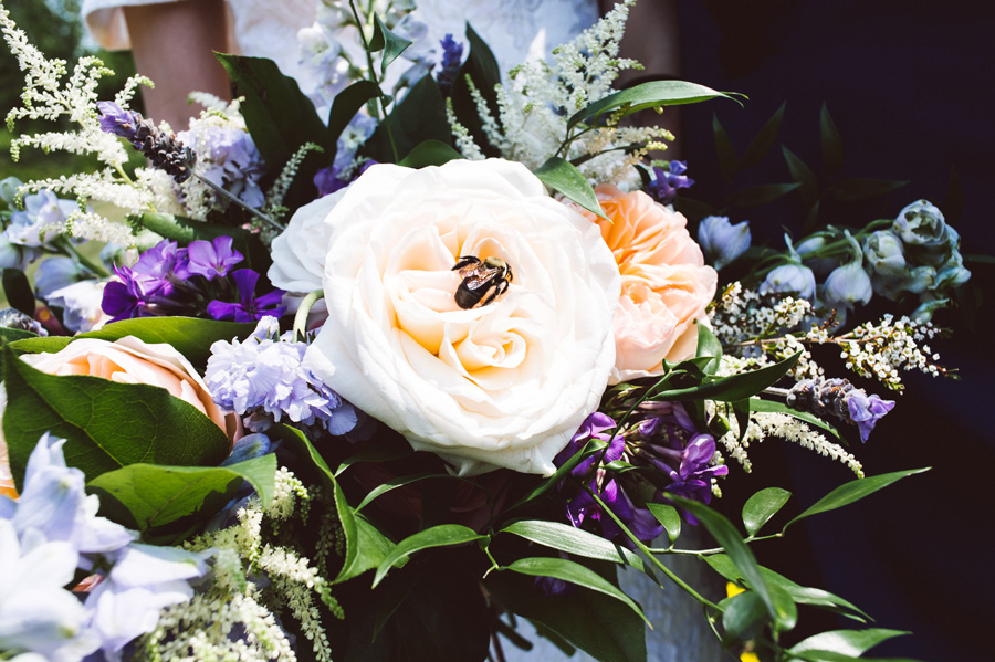 Bumble bee lands on bride's bouquet.