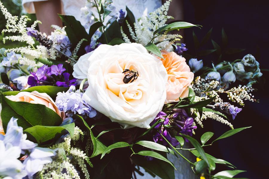 Bumble bee lands on bride's bouquet.