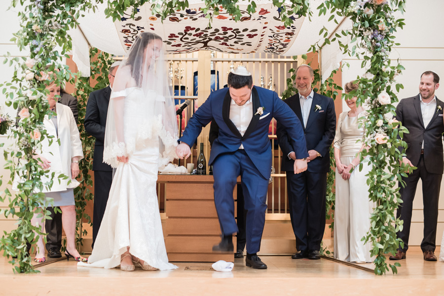 Grom stomps glass at Jewis wedding ceremony.