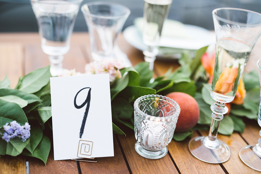 Hand drawn charcoal table number.