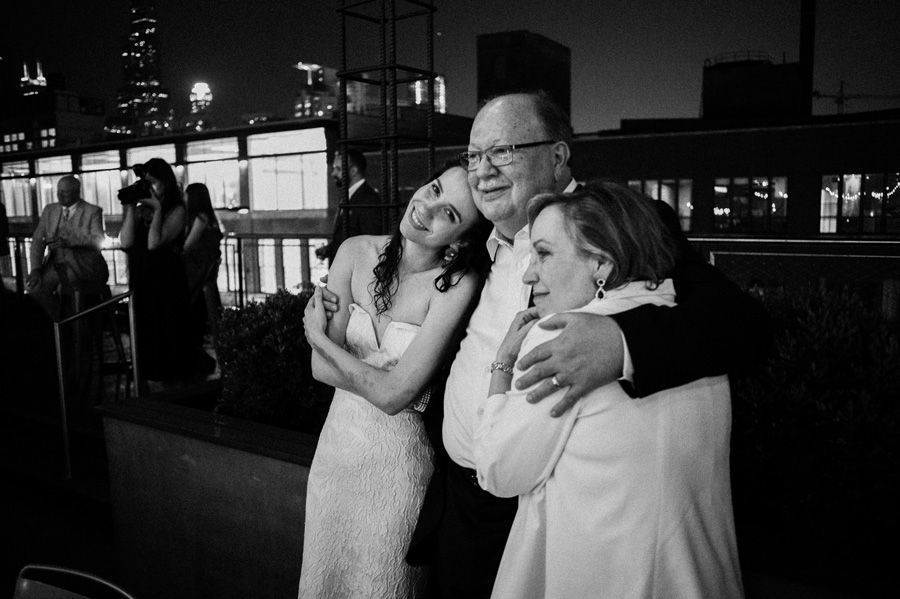 Bride and her parent watch mother son dance.