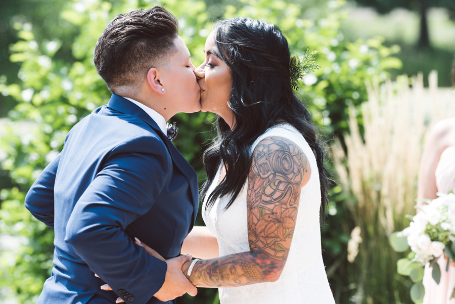 Brides first kiss at wedding ceremony.