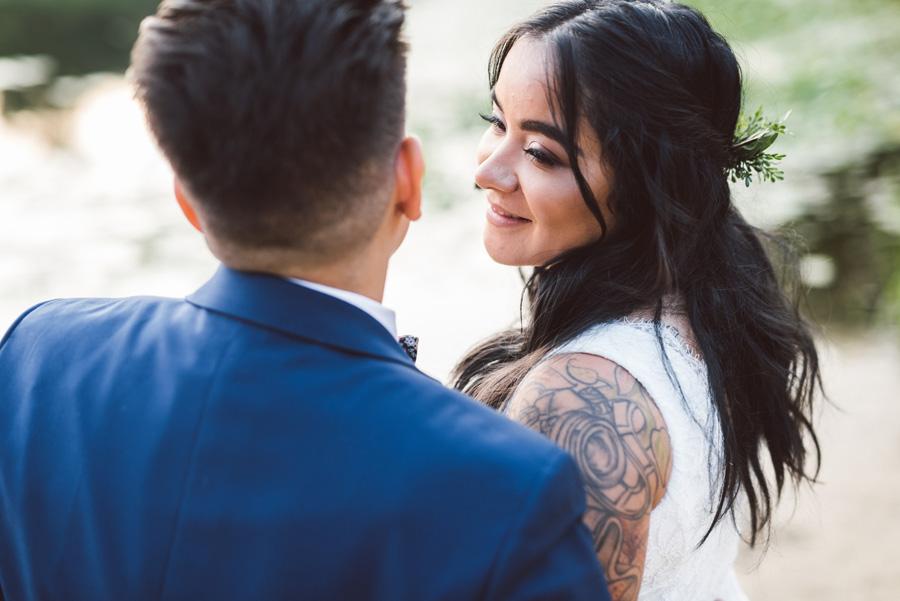 Bride looks at her bride.