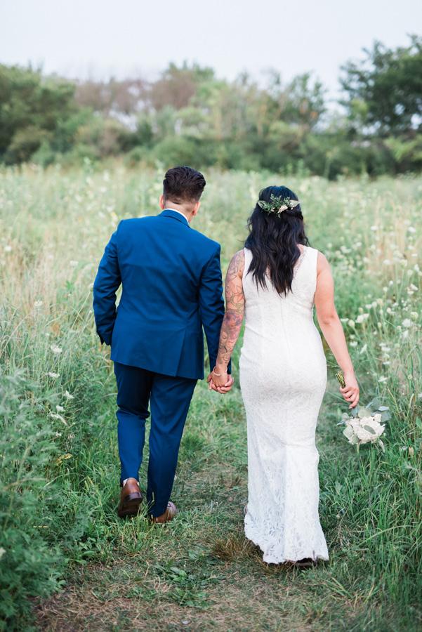Brides walk into field.