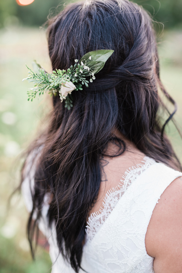 Flower detail in bride's hair.