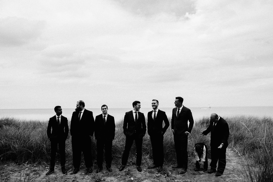 Black and white portrait of groomsmen.