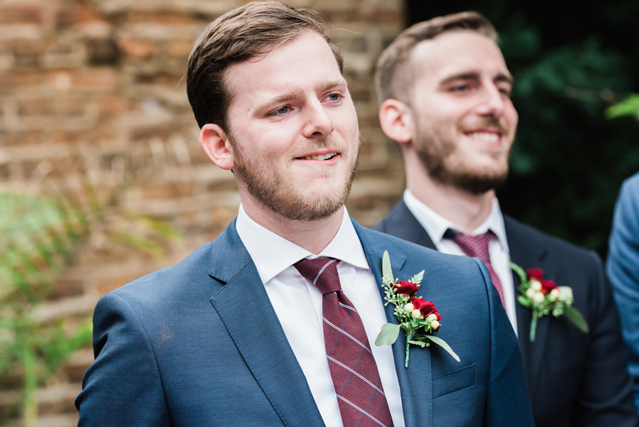 Groom reacts to seeing his bride walk down the aisle.