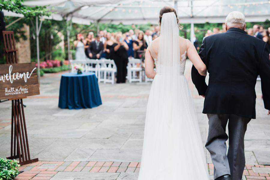 Bride and her grandpa walk down the aisle.