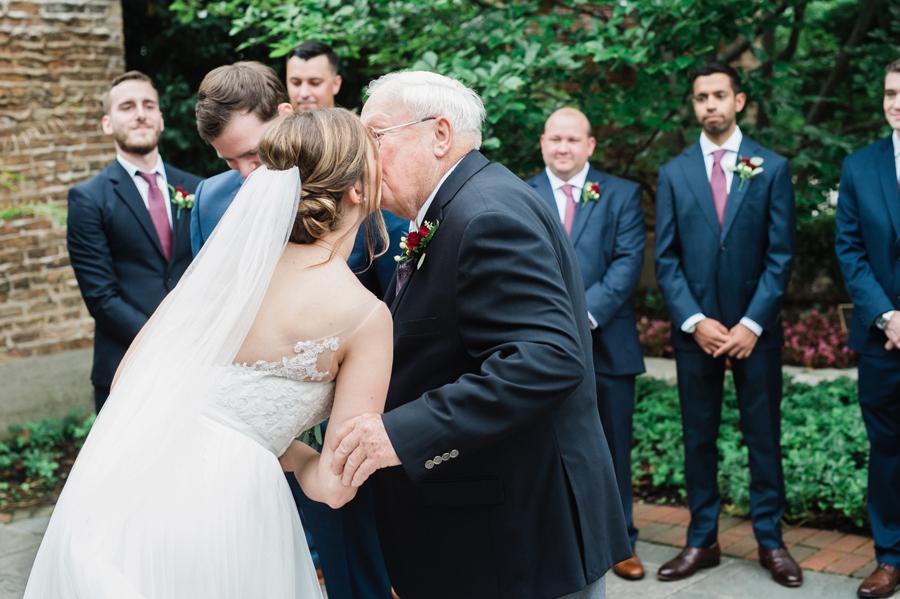 Grandpa kisses his granddaughter.