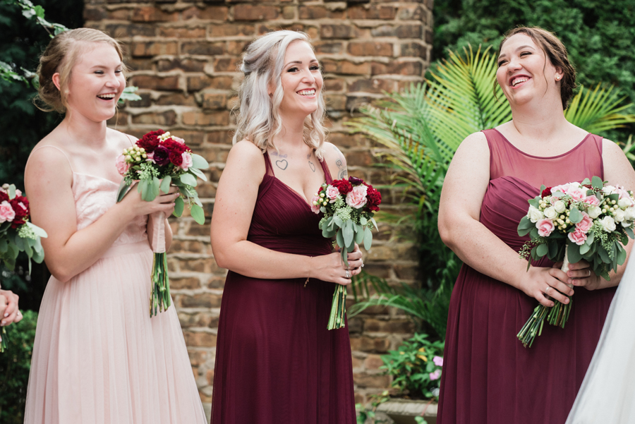 Bridesmaids react at wedding.