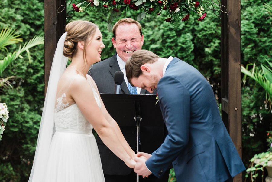 Bride and groom react at wedding ceremony.