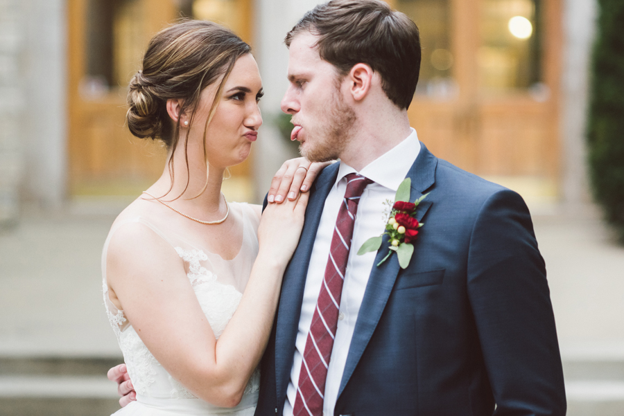 Bride and groom make faces.
