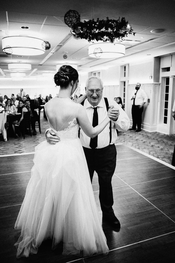 Grandpa and granddaughter dance.