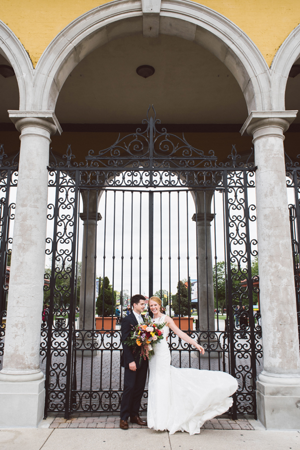 Bride and groom in front of the South Gate at Brookfield Zoo.