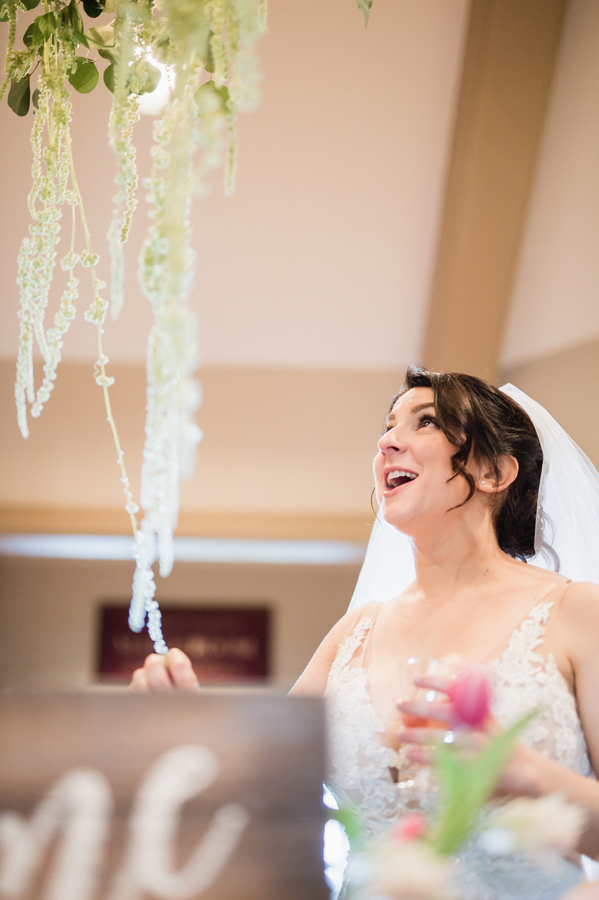 Bride reacts to her reception decor.