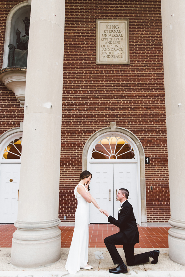 Bride and groom reenact proposal.