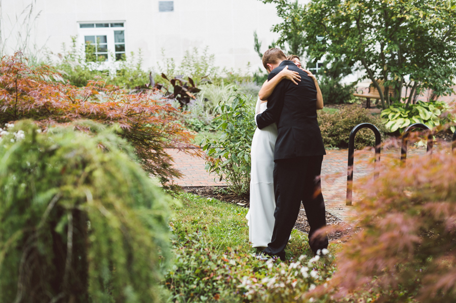 Bride and groom first look at Kalamazoo college.